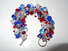 Handmade Patriotic Charm Bracelet: Chunky Cluster Bracelet with Red, Clear and Blue Glass Beads and Star Charms by RoyalStreetBoutique on Etsy