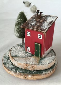 A smaller version of my Christmas House ornaments for those who love a hand made Christmas. These little houses Winter Wonderland pieces of recycled art make a lovely Christmas gift or as a treat for yourself as a cute Christmas Decor snow scene. The bases are made from slices of driftwood
