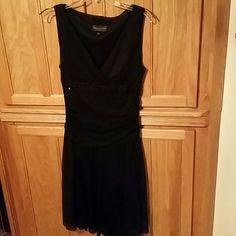 """Black Dress This is that one""""special"""" dress we all NEED for this Christmas and cocktail parties and """"black tie"""" events. I guarantee this will make you feel so beautiful AND comfortable for those parties! Connected Apparel Dresses Midi"""