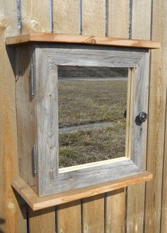 old barn wood made into a small cabinet with mirror