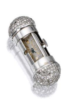 Art DECO__platinum and diamond purse watch PAUL FLATO, circa 1935 T