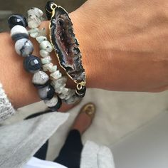The Celeste Bracelet Stack is composed of creamy midnight hues. This stack includes 3 separate bracelets composed of muted matte black beads, a 14k gold edged agate pendant, as well as jagged and face