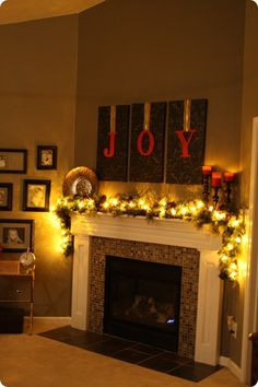 """Wallpaper """"art"""" with red spray-painted lettering hung down.  Cheap, easy, but big impact.  LOVE this idea for over the mantel."""