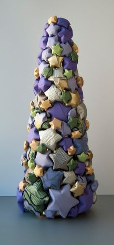 Origami Star Christmas Tree. $60.00, via Etsy.  I love that the designer used non-traditional colors to make this tree.