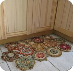 repurposed junk ideas | love this idea to turn old trivets into a floor mat !