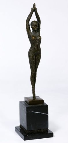 Lot 117: (After) Dimitri Haralamb Chiparus (Romanian, 1886-1947) Figurine; 20th Century re-cast with incised signature at base, depicting an exotic female dancer mounted onto a marble plinth