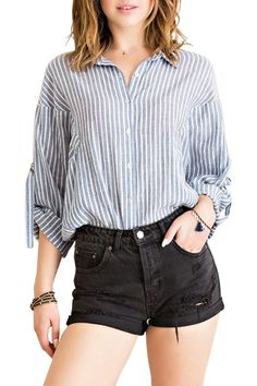 f5d90ad5fc Chic and comfy cotton striped blouse features button-up, spread collar,  three-. Shoptiques