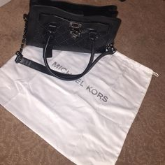MK bag Only used once medium satchel MK bag. Black with sparkle design on front! In prefect condition!!! Comes with MK white bag too Michael Kors Bags