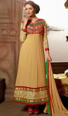 Set the floor ablaze dressed up in this beige embroidered georgette long Anarkali churidar suit. The ethnic floral patch, lace and resham work on the attire adds a sign of magnificence statement for the look.  #LongLengthAnarkaliDresses