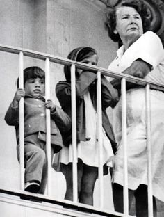 On May 3, 1963, John, 2, and his sister, Caroline, 5, watch a Rose Garden ceremony honoring the nation's war heroes with nanny, Maud Shaw. Miss Shaw was told by Jackie's mother, Janet Auchincloss, to tell the children about their father's death. Later Miss Shaw learned that Jackie had wanted to be the one to tell them, and it caused a rift between the nanny and Mrs. Kennedy. Maud Shaw worked for the Kennedy's from December 1958 until May 1965 when she returned to England.