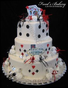 Vegas Wedding Cake - I wouldn't marry in Vegas, but this cake is too fun not to re-pin!