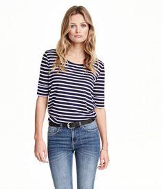 Shirt aus weichem, schmiegsamem Jersey mit langem 1/2-Arm und abgerundetem Saum.