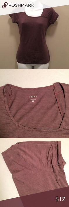 """Nau Top This mauve top features a unique neckline and a flattering cut. This is super comfortable! It is a size XS, but also fits a small. It measures approximately 23"""" from shoulder to bottom hem. Nau Tops"""