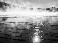 """While on her honeymoon, Your Shot community member and photographer Ani Gypps captured this image of the Grand Prismatic Spring, Yellowstone's colorful and largest hot spring. But the black-and-white treatment she gave this photo seems to have been the best way to evoke the mood she was looking for. """"We arrived late in the day,"""" she writes, """"and the usual beautiful colors were not as visible within that light. But before leaving anywhere I always like to look back at the scene."""