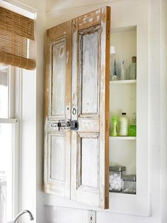 medicine cabinet doors made out of old shutters. I LOVE how the shelf behind door is recessed into the wall.
