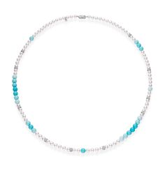 Mikimoto pearl necklace, interspersed with graduated turquoise.