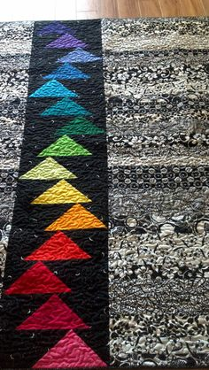 Black and White with bright colors!   Great for a b/w Jelly roll race quilt and add the flying geese insert.