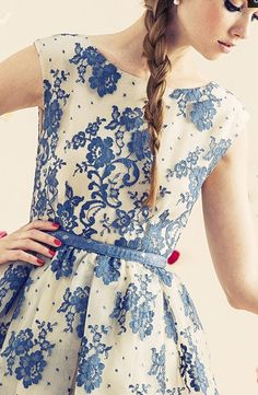 Blue and white dress with blue belt. lace dress.