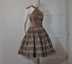50s dress / Cross Ur Heart Halter Vintage1950's Alfred Shaheen Hawaiian Full Skirt Dress. Via Etsy.