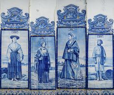 The white washed facade is covered with blue Portuguese tiles (azulejos) which tell a story of a typical everyday life in days past in Aveiro, Portugal