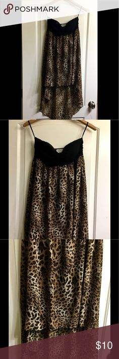 Leopard high low acecemetrical strapless dress This listing is for a leopard Hi low asymmetrical dress The leopard part is Sheer has a black underneath lining it comes to the knee, the top has roughing in the middle of the bust and it is strapless by April USA size medium worn a handful of times still in great condition april usa Dresses Strapless