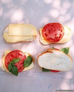 Grilled Cheese with Tomato and Basil - Aromatic basil, slabs of ripe beefsteak tomato, and flavorful Gouda ensure that this is no ordinary grilled cheese. This sandwich is made on the grill, but you could also prepare it in a cast-iron skillet with a little bit of butter melted in the bottom.