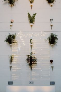 acrylic seating charts - photo by Lisa Woods Photography http://ruffledblog.com/romantic-party-wedding-at-prospect-house