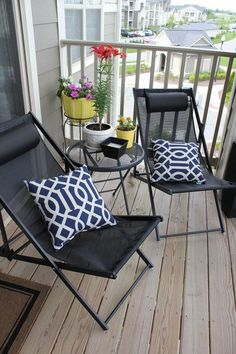 Balcony ideas - folding chairs with pillows and plant stands
