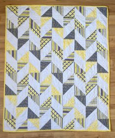Herringbone Half Square Triangle Baby Quilt | Yellow, gray, and white baby quilt. Half square triangles patchwork pieces are arranged to make a herringbone pattern. Carrie Actually xx