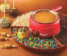 Camarel Apple Candy Dipper  Turn a healthy snack into an artery clogging treat with the caramel apple candy dipper. This 27 oz. dipping pot features a wrap around tray designed to facilitate adhering toppings without making a mess while also keeping caramel at the ideal dipping temperature.  $21.19  Check It Out  Awesome Sht You Can Buy