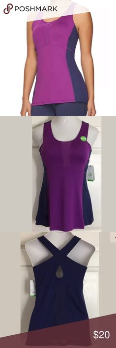 "Gaiam Yoga Racerback Athletic Purple Blue Tank Top Flattering purple and navy blue racerback focus yoga workout top. Has a shelf bra with removable padded cups. Bust: 36""; Length in the back from the shoulder: 26"". 90% Polyester, 10% Spandex. Smoke free home. Thanks for shopping my closet ! Gaiam Tops Tank Tops"