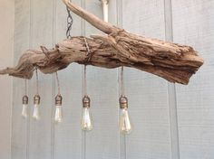 Driftwood Chandelier/ Table Light ,Lakeside Mountain Retreat ,Rustic Chic by MidCenturyRewind on Etsy https://www.etsy.com/listing/496682054/driftwood-chandelier-table-light
