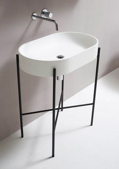 Minimal bathroom furniture designed by Danish studio Norm Architects.