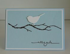 handmade card ... clean and simple design ... pastel blue striped paper background .. Memory Box delicate twiggy branch in black .. white die cut bird ... delightful card!! ... Stampin' Up!
