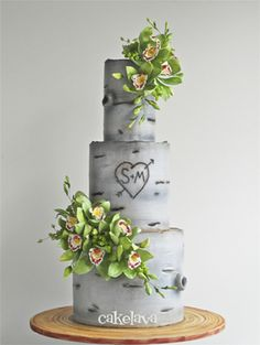 Nature inspired wedding cake: a birch tree bark pattern with the bride and groom's initials in a heart and faux greenery decor. | cakelava in Las Vegas, NV