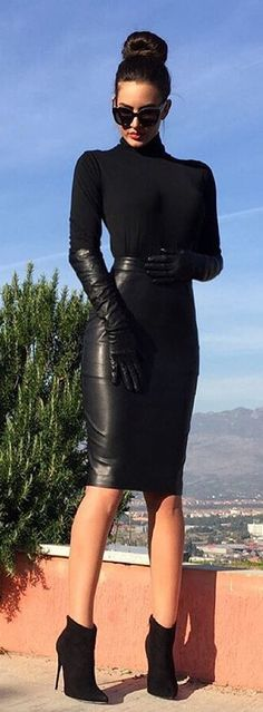 A celebration of beautiful women wearing leather. I love the dominance of leather! Why are there...