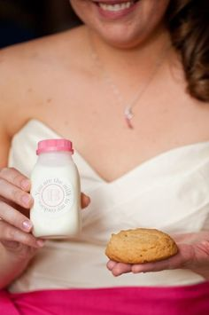 "Bride holding a fun pink evening favor of milk and cookies with a custom label ""You are the milk to my cookies."" Flowers - www.intrigue-desi... Photos - www.lizandryan.com Paper & Design - www.allisonbarnhi... Vintage Rentals @2hands studios @Allison Barnhill @Liz and Ryan Bower (I am missing a number of vendors. This will be updated shortly to list everyone's credit)"