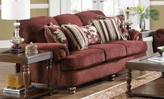 Belmont Sofa - The Traditional Style. Here is a traditional styled sofa that has deep seating comfort and a larger scale for family seating. Round arms and turned wood feet adds a decorative touch. Upholstered in luxurious textured diamond motif burgundy chenille fabric and seat cushions are reversible. Five fringed accent pillows all in versatile and coordinated patterns. - Grand Home Furnishings | 0238463