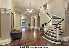 Foyer with curved staircase View Large Photo Image