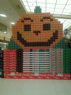 A coca-cola display at Publix. The pumpkin is Orange Fanta and Coke Zero.