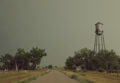 I found a ghost town while driving though the midwest. I spent the day wading through dead grass and exploring the vacant homes. A rusty water tower lay on the outskirts of the town and the yards were...