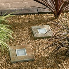 Slate Step Lights - These clever little stepping stones actually provide their own light. It's a great way to provide the surface you need and the lighting that makes it practical at night. Perfect for edging front walks or create a pattern down your garden path for a cool effect.