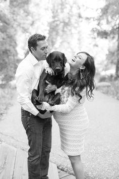 Black and white maternity photo with dog by Skyla Walton