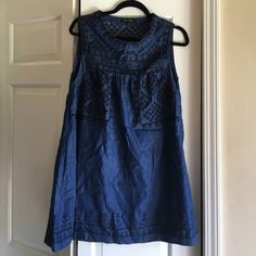 Denim dress with black stitching Adorable baby doll style dress made out of denim material! it has black stitching and there is a pocket on the right side. No trades fits like a m/l Altar'd State Dresses