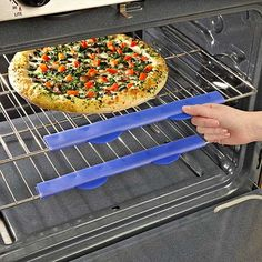 Silicone Oven Rack Guard. It's simply a pair of silicone guards that line the outer edge of your oven racks and allow you to pull the oven racks out with your bare hands. No need for pot holders, oven mitts, or towels, the silicone stays cool up to 450 degrees. They cost less than $10 for a set of two