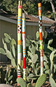 Russel Sally – Nance InWA Russel Sally Paint the bamboo poles like this for the garden. Garden Crafts, Garden Projects, Diy Garden, Garden Ideas, Peace Pole, Painted Bamboo, Garden Poles, Bamboo Poles, Stick Art