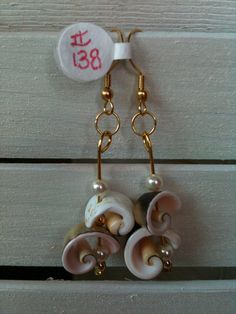 Natural Shell Loop Earrings with Pearls & Gold on by GodsGlitter