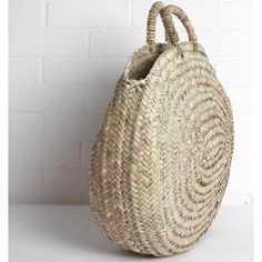 A beautiful round shopping basket, the perfect accessory for any outfit. Ethically made in Morocco, handwoven using palm leaves supporting meaningful employment and ensuring the survival of amazing traditional crafts.