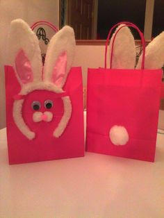 Bunny Party Favor Bags...bunny ear headband, pom poms, google eyes and even fishing line whiskers (you can't see them in the photo).