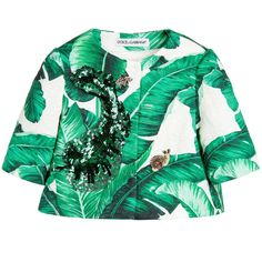 Girls green and white botanical brocade jacket by Dolce & Gabbana. Woven in a cotton and silk blend, this beautiful jacket is printed with the designer's striking banana leaf, in a design inspired by the botanical gardens of Palermo. The style has a boxy fit and is collarless, with a concealed front popper fastening and three-quarter length sleeves. There is lovely sequin embroidery and rhinestone embellished bee and insect appliqué, with a silky lining.